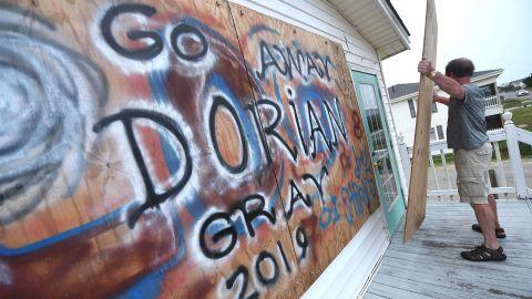 Bob Quarles boards up his beach house in Oak Island, North Carolina, on September 4.