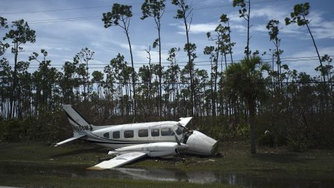 A broken plane rests on the side of a road in Freeport.