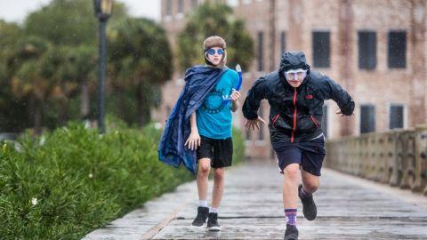 Braden Vick, right, and Scott Ray run along The Battery in Charleston, South Carolina, on September 4.