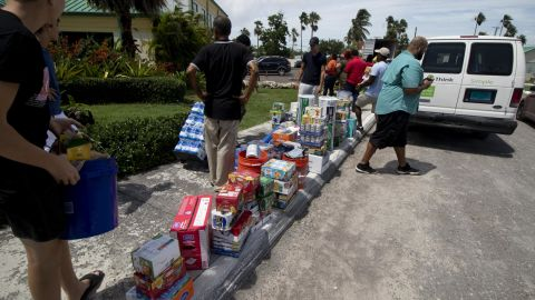 Volunteers receive relief supplies at the New Providence Community Center in Nassau.