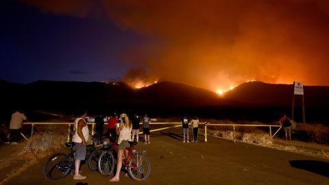 Residents watch as the Tenaja Fire burns in Murrieta, California.