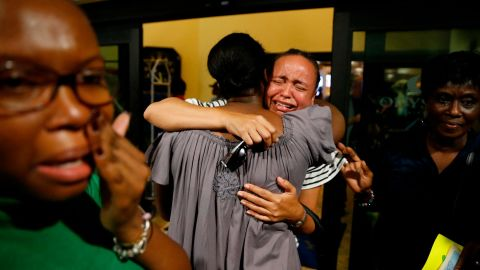 Roshane Eyma cries as she is greeted by members of her church on September 4. She had been rescued and flown to Nassau, Bahamas.