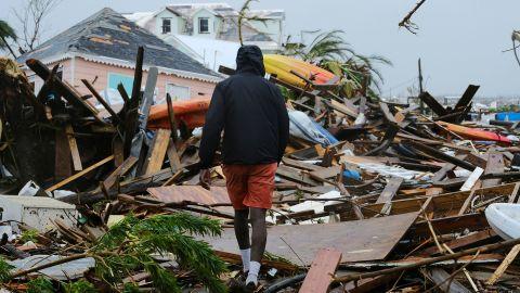 A man walks through the rubble left by Hurricane Dorian in Marsh Harbour, Bahamas, on September 2.