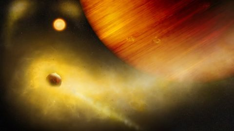 This is an illustration of an exomoon losing mass as it's being pulled around the gas giant it orbits.