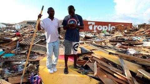 Two men stand amid the destruction in Marsh Harbour, Bahamas, on September 5.