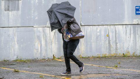 A woman battles rain and wind in Charleston, South Carolina, on September 5.