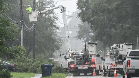 Utility crews work on restoring power in Myrtle Beach, South Carolina, on September 5.