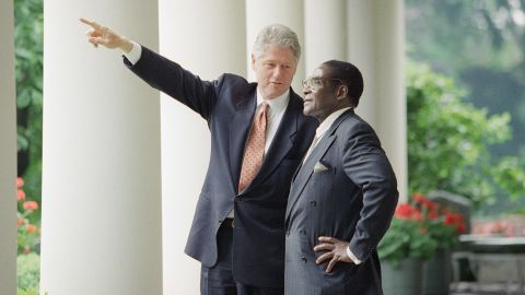 US President Bill Clinton gestures while talking to Mugabe after a White House meeting in Washington in May 1995.