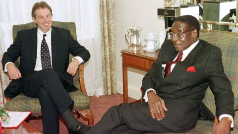 British Prime Minister Tony Blair talks with Mugabe in October 1997, before the start of the Commonwealth Heads of Government meeting.
