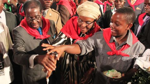 Mugabe cuts his birthday cake with his wife, Grace, and son Bellarmine Chatunga during celebrations in Harare in February 2011. Mugabe was turning 87.