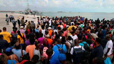 Evacuees wait to leave Marsh Harbour in the Bahamas.