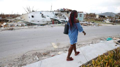 Schemelda Saintilien walks past debris and damaged houses on the Bahamas' Great Abaco island.