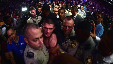 Nurmagomedov is escorted out of the arena after defeating Conor McGregor.