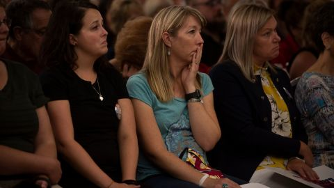 Members of the audience react during a Gun Safety Town Hall in Aurora, Colorado on August 25.