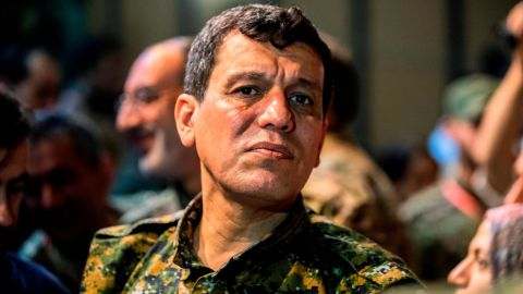 """Mazloum Kobani, commander-in-chief of the Syrian Democratic Forces (SDF), attends a meeting with other commanders and representatives of the US-led coalition fighting the Islamic State (IS) group, in the northwestern Syrian city of Hasakah, in the province of the same name, on August 24, 2019. - Syria's Kurds said on August 24 that they would support the implementation of a US-Turkey deal to set up a buffer zone in their areas along the Turkish border. The so-called """"safe zone"""" agreed by Washington and Ankara earlier this month aims to create a buffer between the Turkish border and Syrian areas controlled by the Kurdish People's Protection Units (YPG). The YPG have played a key role in the US-backed battle against the Islamic State group in Syria, but Ankara views them as """"terrorists"""". (Photo by Delil SOULEIMAN / AFP)        (Photo credit should read DELIL SOULEIMAN/AFP/Getty Images)"""