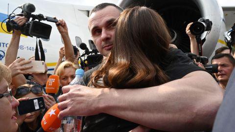 Ukrainian film director Oleg Sentsov hugs his daughter after arriving back in Kiev .