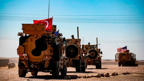 Turkish and US military vehicles drive on a joint patrol in the Syrian village of al-Hashisha on the outskirts of Tal Abyad town on the border with Turkey, on September 8, 2019.
