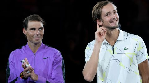 Daniil Medvedev asks for the fans to give him more applause during the trophy presentation Sunday at the US Open.