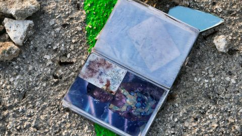A photo album is seen amid the debris in Marsh Harbour on Sunday, September 8.
