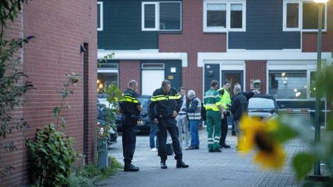Police investigate a house after a shooting incident in the Dutch city of Dordrecht.