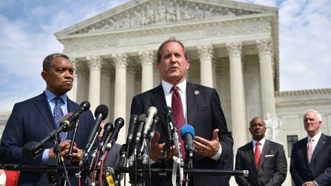 """District of Columbia Attorney General Karl Racine (L) and Texas Attorney General Ken Paxton speak during the launch of an antitrust investigation into large tech companies outside of the US Supreme Court in Washington, DC on September 9, 2019. - The backlash against Big Tech heads into a new phase Monday with another broad antitrust investigation, highlighting the mounting legal challenges facing the dominant online platforms. Top legal officials from dozens of US states were set to unveil a probe of Google over allegations of """"anticompetitive behavior,"""" days after a separate coalition announced a similar investigation of social networking giant Facebook. (Photo by MANDEL NGAN / AFP)        (Photo credit should read MANDEL NGAN/AFP/Getty Images)"""