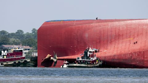 Rescuers work near the stern of the Golden Ray.