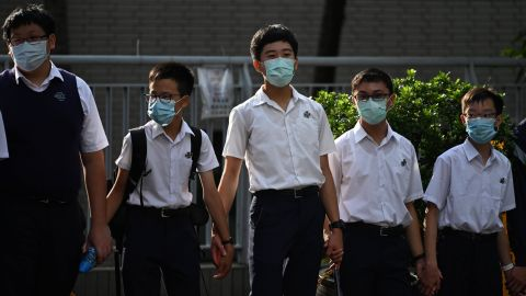 Students in the Mid-Levels area take part in a joint school human chain rally in Hong Kong early on September 9, 2019. - The protests over the last 14 weeks were lit by a now-scrapped plan to allow extraditions to the authoritarian mainland, seen by opponents as the latest move by China to chip away at the international finance hub's unique freedoms. (Photo by Anthony WALLACE / AFP)        (Photo credit should read ANTHONY WALLACE/AFP/Getty Images)