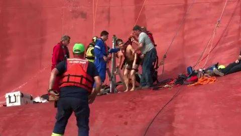 Rescuers extract the final crew member from the Golden Ray.