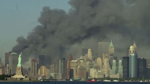 Thick smoke rises over the New York City skyline after the World Trade Center towers were downed by terrorists on September 11, 2001.