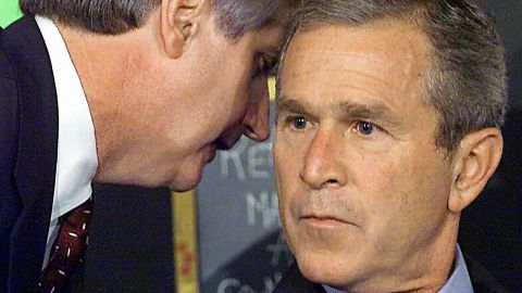 """White House Chief of Staff Andrew Card whispers into the ear of US President George W. Bush as Bush was visiting an elementary school in Sarasota, Florida. <a href=""""http://www.sfgate.com/news/article/9-11-Voices-What-If-You-Had-To-Tell-The-2799179.php"""" target=""""_blank"""" target=""""_blank"""">""""America is under attack,"""" he said.</a>"""