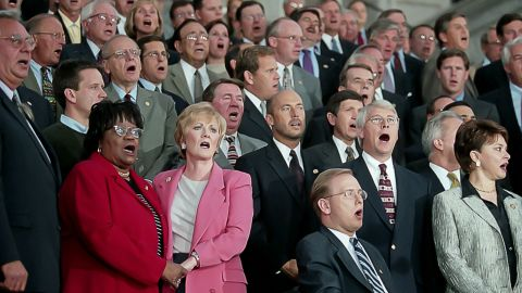 """Members of Congress gather on the east steps of Capitol Hill and sing """"God Bless America"""" to denounce the terrorist attacks."""