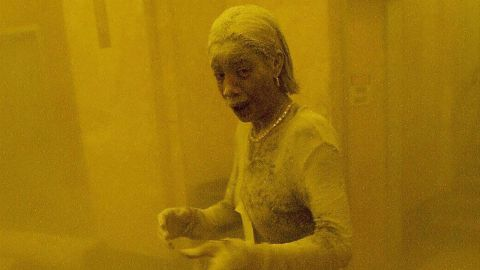"""Marcy Borders stands covered in dust as she takes refuge in an office building after one of the World Trade Center towers collapsed. Borders, who became known as """"Dust Lady,"""" <a href=""""http://www.cnn.com/2015/08/26/us/9-11-survivor-dust-lady-dies/index.html"""" target=""""_blank"""">died of stomach cancer in 2015.</a> She was 42."""
