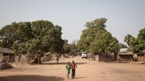 Two young boys walk in the main street of Tiringoulou, northern Central African Republic.