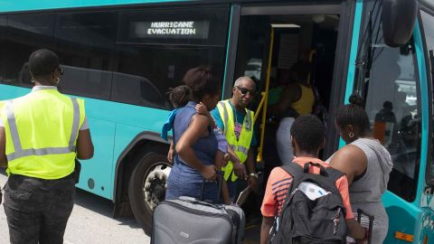 WEST PALM BEACH, FL - SEPTEMBER 07: People board a bus at Port of Palm Beach after arriving on the cruise ship Grand Celebration on September 7, 2019 in West Palm Beach, Florida. The ship arrived with hundreds of evacuees impacted by Hurricane Dorian in the Bahamas (Photo by Saul Martinez/Getty Images)