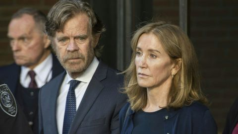 Actress Felicity Huffman, escorted by her husband William H. Macy, exits the US courthouse in Boston, after her sentencing on September 13, 2019.