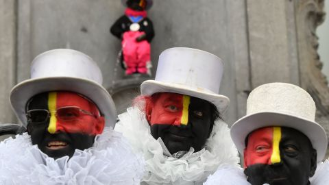"""The """"Noirauds"""" or """"Blackies"""" -- a group that marks Belgium's annual carnival season by charitable fund-raising in black face paint -- changed their colours to resemble the Belgian flag in 2019."""