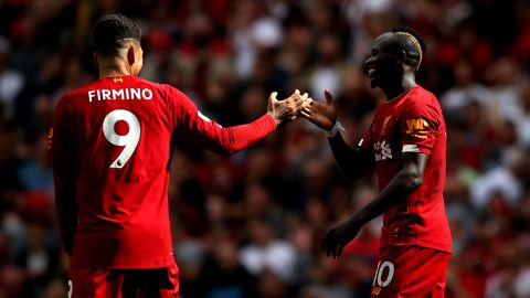 LIVERPOOL, ENGLAND - SEPTEMBER 14: Sadio Mane of Liverpool celebrates with Roberto Firmino after he scores his team's second goal during the Premier League match between Liverpool FC and Newcastle United at Anfield on September 14, 2019 in Liverpool, United Kingdom. (Photo by Jan Kruger/Getty Images)