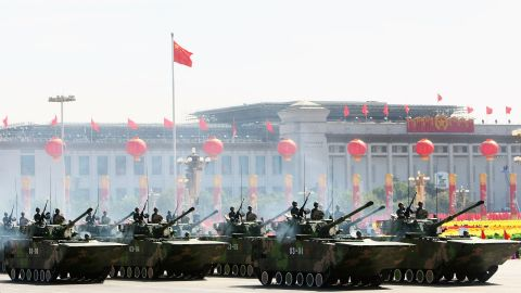 Chinese tanks rumble pass Tiananmen Square during a massive parade to celebrate the 60th anniversary of the founding of the People's Republic of China on October 1, 2009 in Beijing.