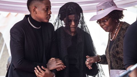 Zimbabwe's former first lady Grace Mugabe, center, attends the official farewell ceremony for her late husband Robert Mugabe.