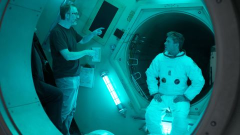 """James Gray (left) directs Brad Pitt (right) on the set of upcoming sci-fi thriller """"Ad Astra."""""""