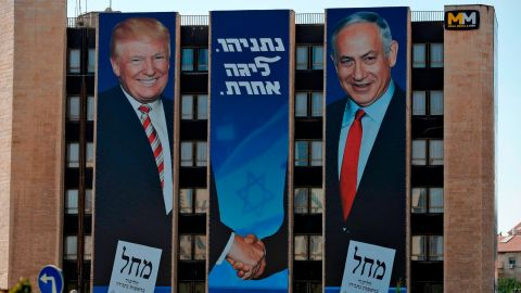 """An election banner on a Jerusalem building shows Netanyahu shaking hands with US President Donald Trump. Trump remains <a href=""""https://www.cnn.com/2019/09/16/middleeast/israel-netanyahu-trump-intl/index.html"""" target=""""_blank"""">incredibly popular in Israel</a> — far more popular than he is in the United States."""