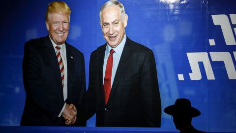 An Israeli election billboard for the Likud party in September showed US President Donald Trump shaking hands with  Netanyahu.