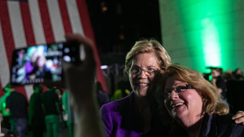 Sen. Elizabeth Warren, poses for a photograph with a supporter during an event at Washington Square Park in New York, U.S., on Monday, September 16, 2019.