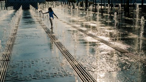 <strong>Moscow: </strong>A child plays in fountains in Gorky Park on a warm September day.
