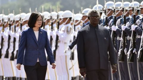 Solomon Islands President Manasseh Sogavare (R) and Taiwan President Tsai Ing-wen (L) inspect an honour guard during a welcome ceremony in Taipei on September 26, 2017.