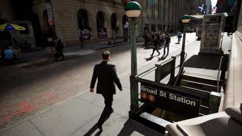 A pedestrian walks along Wall Street near the New York Stock Exchange (NYSE) in New York, U.S., on Monday, Sept. 11, 2017. The record-setting rally inU.S. stocksis back on. After a five-week hiatus without any all-time highs, the S&P 500 Index climbed as much as 0.9 percent to 2,483.81 and was poised for its 31st record close this year. Photographer: Michael Nagle/Bloomberg via Getty Images