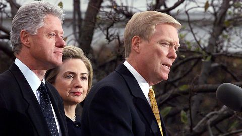 The Clintons listen as House Minority Leader Dick Gephardt addresses the nation oat the White House in December 1998.  It was after the House of Representatives voted to impeach the President on charges of perjury and obstruction of justice related to the Lewinsky scandal. A defiant Clinton rejected calls for his resignation.