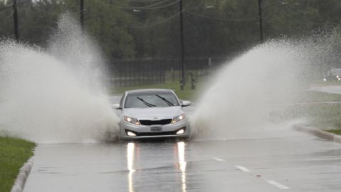 A car navigates floodwaters from Tropical Depression Imelda on Wednesday in Houston.