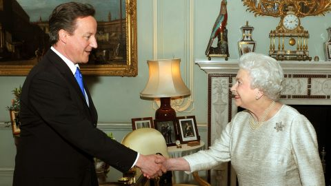 LONDON - MAY 11:  Britain's Queen Elizabeth II greets David Cameron at Buckingham Palace in an audience to invite him to be the next Prime Minister, on May 11, 2010 in London. After five days of negotiation a Conservative and Liberal Democrat coalition government has been confirmed. Gordon Brown has resigned his position and David Cameron has become the new British Prime Minister.  (Photo by John Stillwell/WPA Pool/Getty Images)