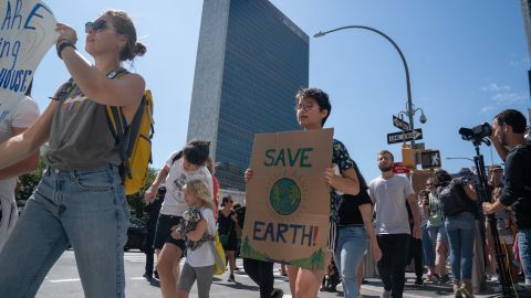 """Climate activist protest near the UN headquarters on August 30, 2019, in New York. - Swedish climate change campaigner Greta Thunberg joined hundreds of other teenagers protesting outside the United Nations Friday in her first demonstration on US soil since arriving by zero-carbon yacht. Thunberg, 16, has spurred teenagers and students around the world to gather every Friday under the rallying cry """"Fridays for future"""" to call on adults to act now to save the planet. (Photo by Bryan R. Smith / AFP)        (Photo credit should read BRYAN R. SMITH/AFP/Getty Images)"""